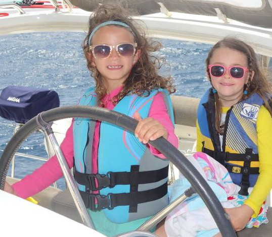 Anna (left) and her best bud sailing the big cat.  (Photo credit:  Laura Ward)